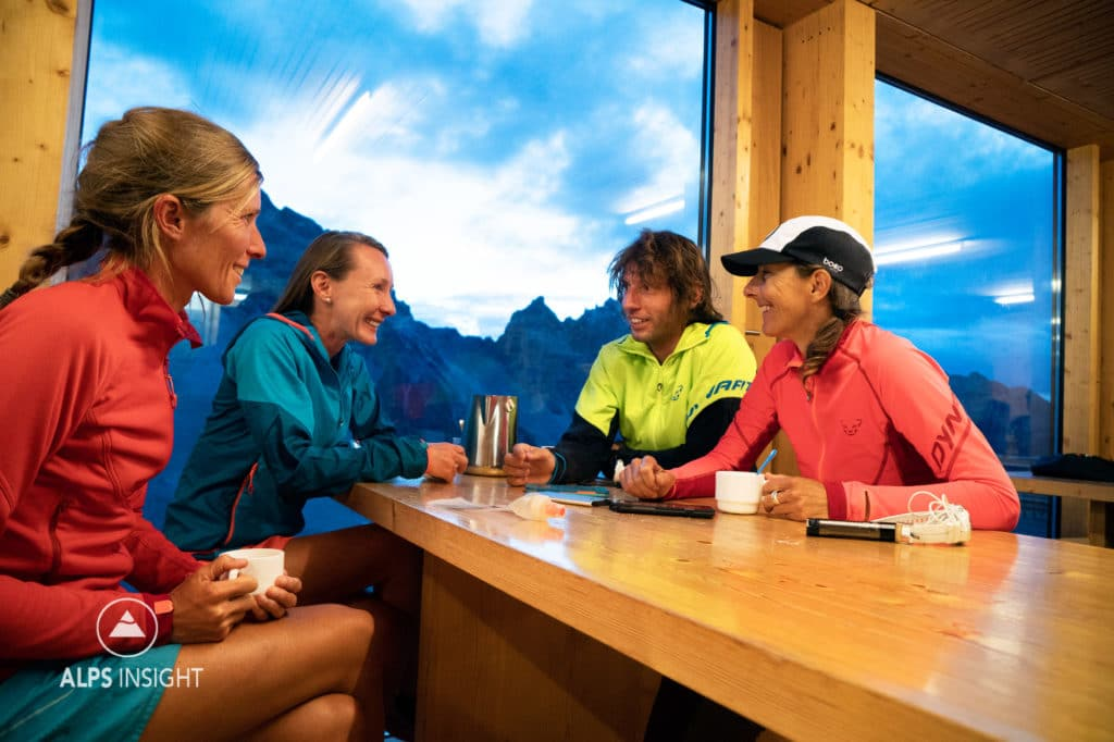 A group of friends in the Cabane de Moiry during the Via Valais, a multi-day trail running tour connecting Verbier with Zermatt, Switzerland.