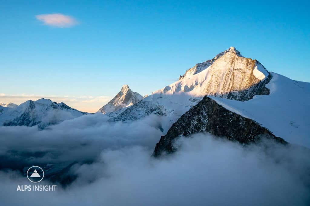 Sunrise in the Swiss Alps. Matterhorn, Dent Blanche and Grand Cornier.