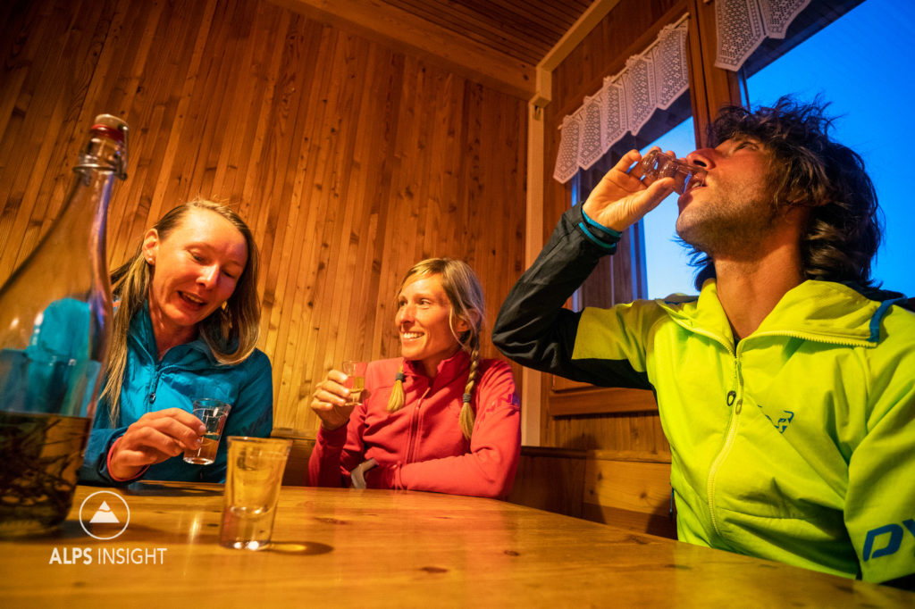 Drinking schnapps at the Turtmann Hut during the Via Valais, a multi-day trail running tour connecting Verbier with Zermatt, Switzerland.
