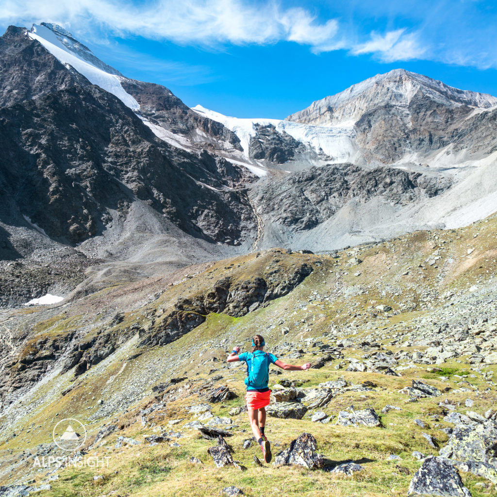 Trail running down to Randa while on the Via Valais, a multi-day trail running tour connecting Verbier with Zermatt, Switzerland.