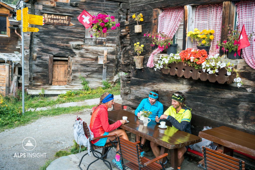 Runners stopped in Zmutt for a coffee at a small cafe, while on the last day of the Via Valais, a multi-day trail running tour connecting Verbier with Zermatt, Switzerland.
